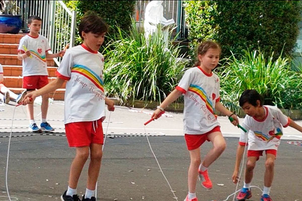 students skipping rope at school