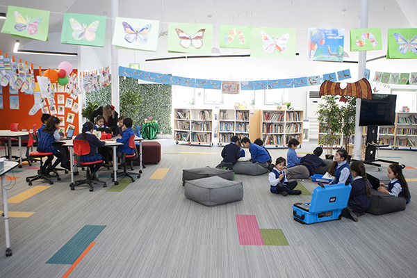 students reading and doing work in the flexible learning areas