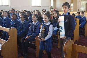 students in offertory in a mass